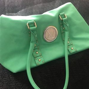 Handbags - A beautiful green purse of an unknown brand.